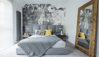 Łóżko tapicerowane - dlaczego warto je wybrać do sypialni?
